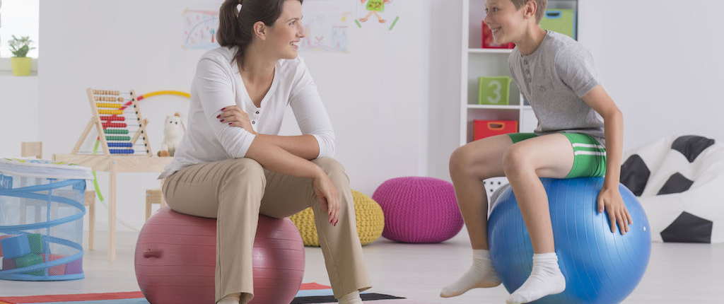 Denver Counseling Solutions boy sitting on gym ball PKP68SW